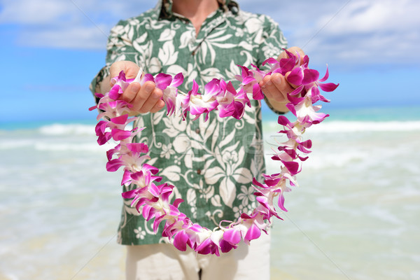 Hawaii tradition - giving a Hawaiian flowers lei Stock photo © Maridav
