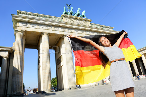 German flag woman joy at Berlin Brandenburger Tor Stock photo © Maridav