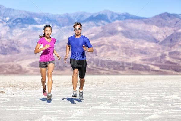Running Determined Couple Jogging Against Mountain Stock photo © Maridav