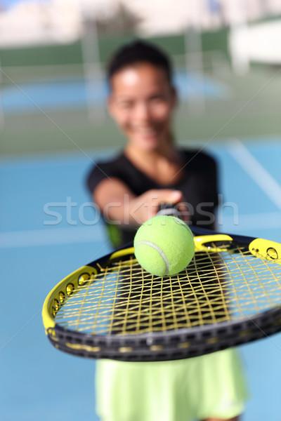 Tennis player showing ball on racquet net Stock photo © Maridav