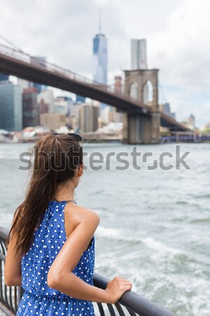 Stock photo: Woman looking at Brooklyn bridge and New York skyline on summer travel