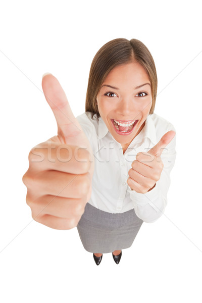 Happy excited woman giving thumbs up Stock photo © Maridav