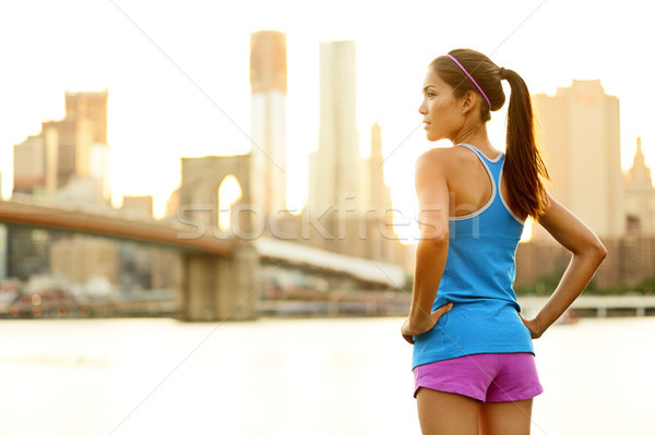 Fitness woman runner relaxing after city running Stock photo © Maridav