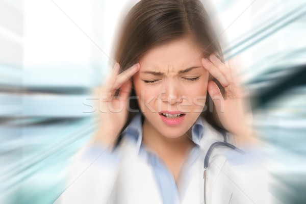 Migraine and headache people - Doctor stressed Stock photo © Maridav