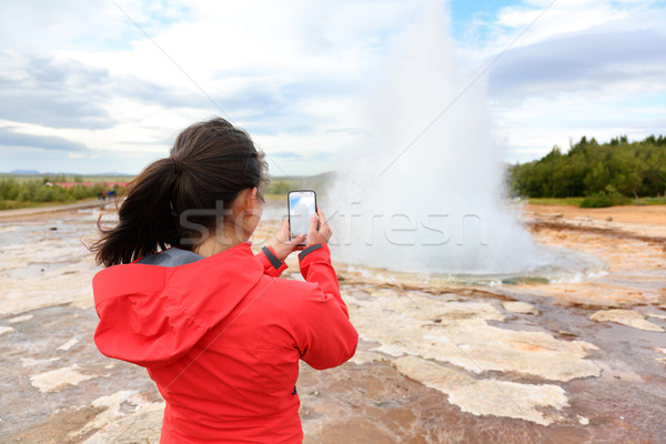 Iceland tourist taking photos of geyser Strokkur Stock photo © Maridav