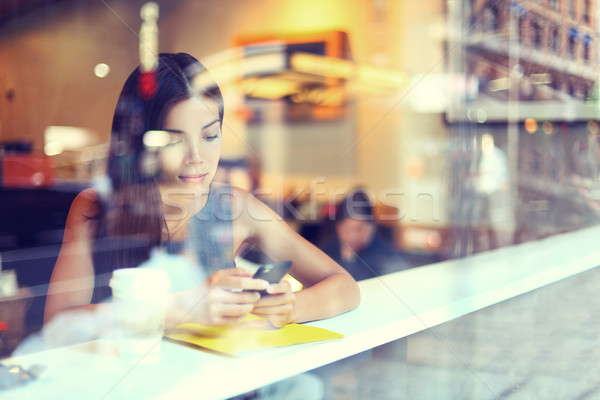 Cafe city lifestyle woman on phone drinking coffee Stock photo © Maridav