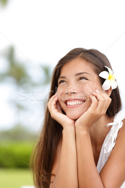 Stock photo: Natural girl smiling and daydreaming happy cute