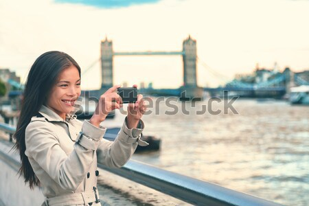 London woman tourist taking photo on Tower Bridge Stock photo © Maridav