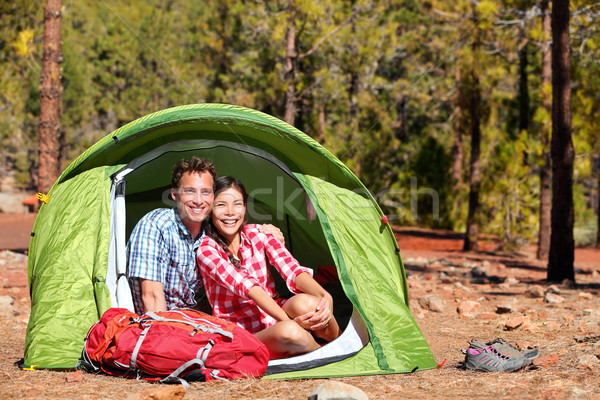 People camping in tent - happy backpacking couple Stock photo © Maridav