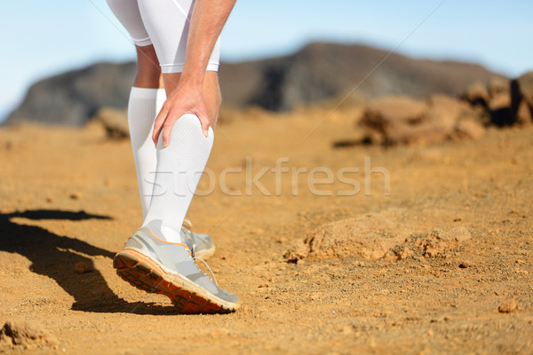 Running Cramps in leg calves sprain calf on runner Stock photo © Maridav