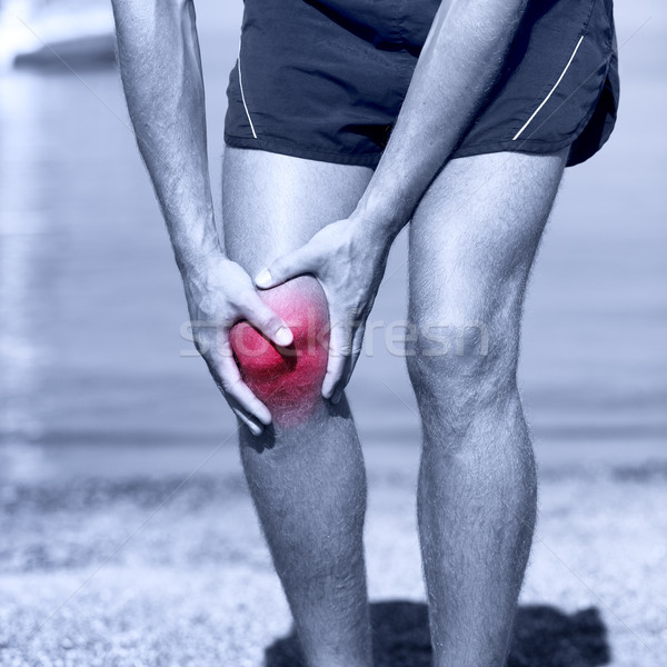 Knee Injury - sports running knee injuries on man Stock photo © Maridav