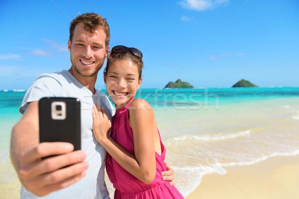 Stockfoto: Smartphone · strand · vakantie · paar · foto