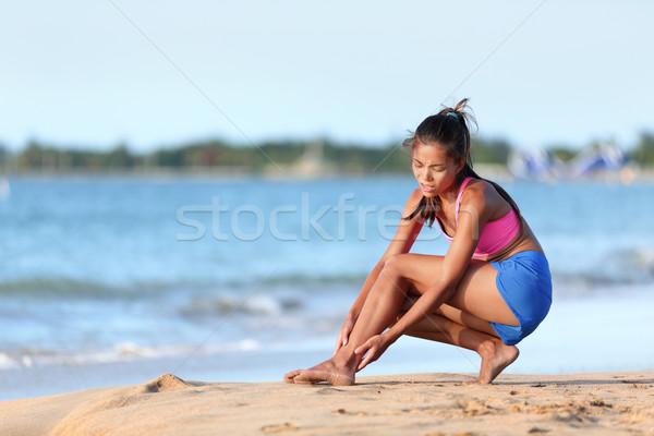 Jogger souffrance cheville douleur plage courir Photo stock © Maridav