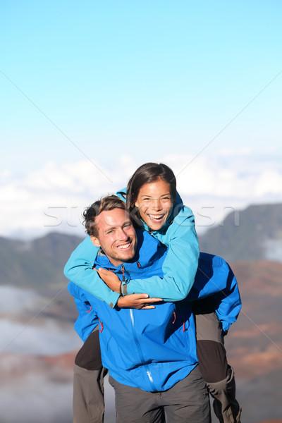 Hiking couple piggybacking happy Stock photo © Maridav