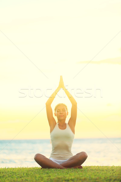 Yoga woman relaxing by sea Stock photo © Maridav
