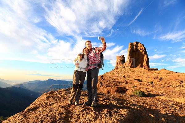 Couple taking selfie hiking in beautiful nature Stock photo © Maridav