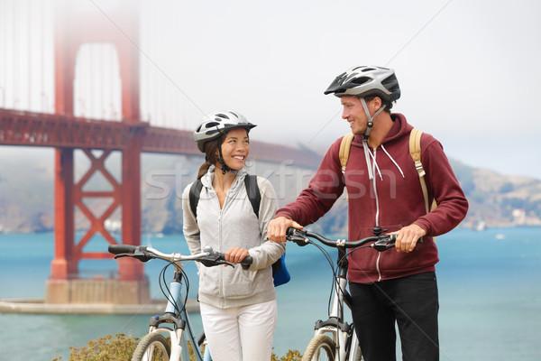 Biking Golden Gate Bridge - couple sightseeing Stock photo © Maridav