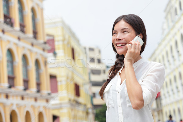 Business woman talking on smart phone in Macau Stock photo © Maridav