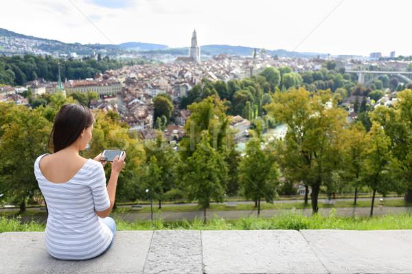 Tourist with smart phone camera in Bern Stock photo © Maridav
