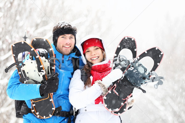Winter couple outdoors on snowshoes Stock photo © Maridav