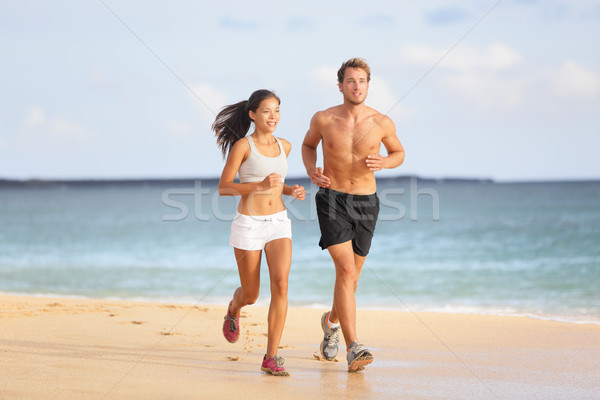 People running - young couple jogging on beach Stock photo © Maridav
