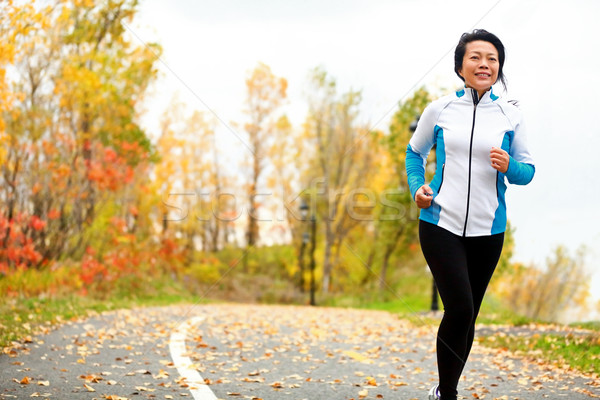 Mature Asian woman running active in her 50s Stock photo © Maridav