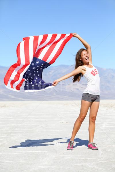 US flag - woman athlete showing american flag USA Stock photo © Maridav