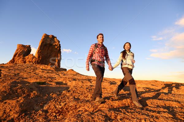 Hikers hiking in beautiful landscape Stock photo © Maridav