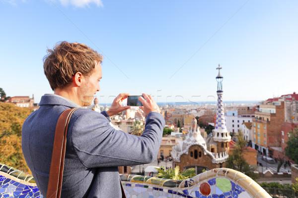 Tourist man taking photo in Park Guell, Barcelona Stock photo © Maridav