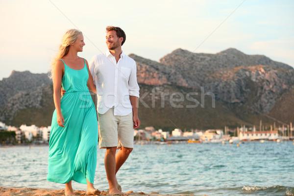Beach couple holding hands walking at sunset Stock photo © Maridav