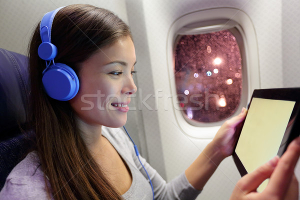 Passenger in airplane using tablet computer Stock photo © Maridav