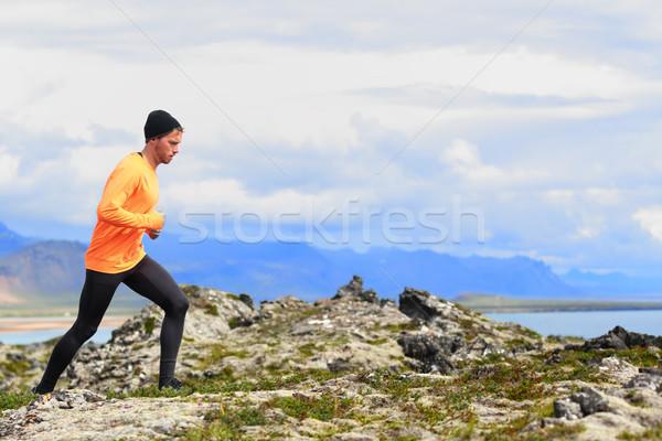 Running sport man in cross country trail run Stock photo © Maridav