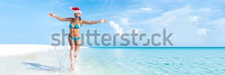 Beach fun vacation carefree woman splashing water  Stock photo © Maridav
