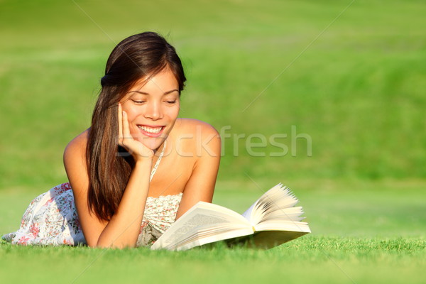 Woman reading book in park Stock photo © Maridav