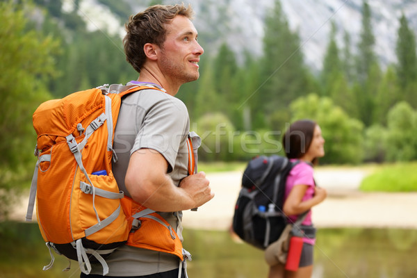 Hikers - people hiking, man looking in Yosemite Stock photo © Maridav