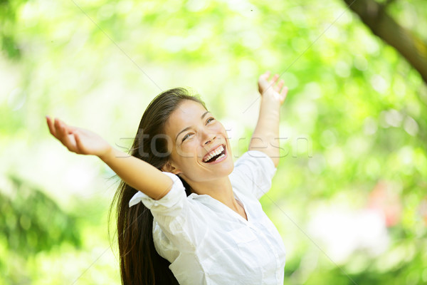 Carefree elated cheering woman in spring or summer Stock photo © Maridav