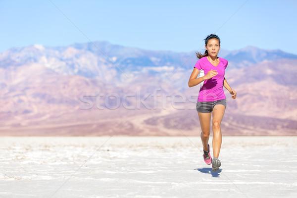 Running sport athlete woman sprinting in trail run Stock photo © Maridav