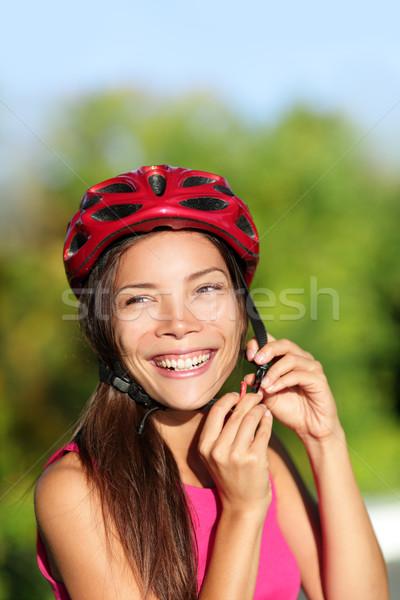 Biking helmet - woman putting bicycle helmet Stock photo © Maridav