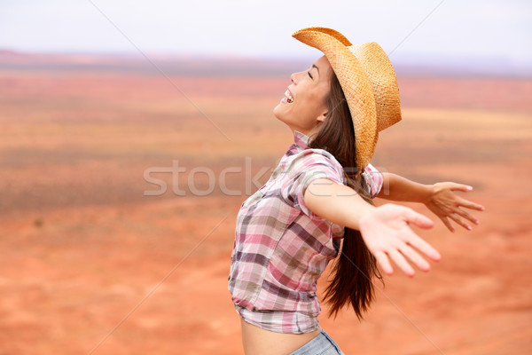 Cowgirl - woman happy and free on american prairie Stock photo © Maridav