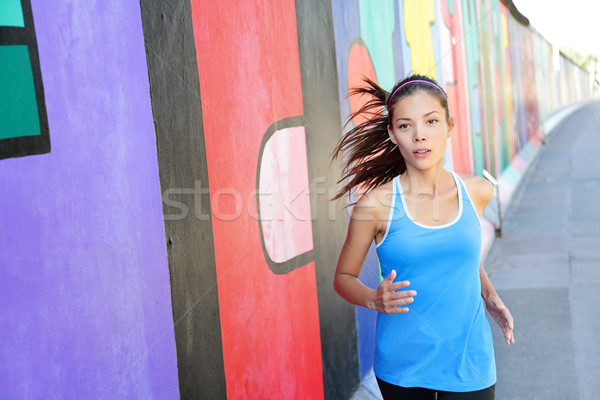 Running woman jogging by Berlin Wall, Germany Stock photo © Maridav