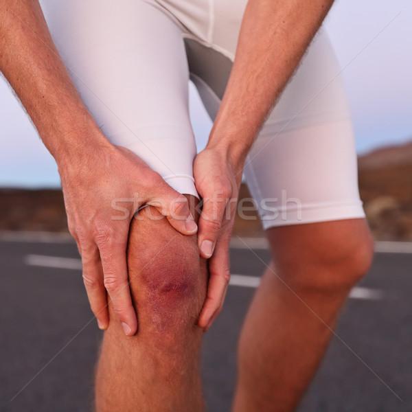 Knee injury - athlete runner with sport injury Stock photo © Maridav