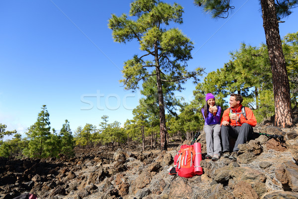 Hiking hikers couple relaxing eating lunch Stock photo © Maridav