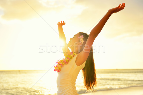 Happy carefree woman free in Hawaii beach sunset Stock photo © Maridav