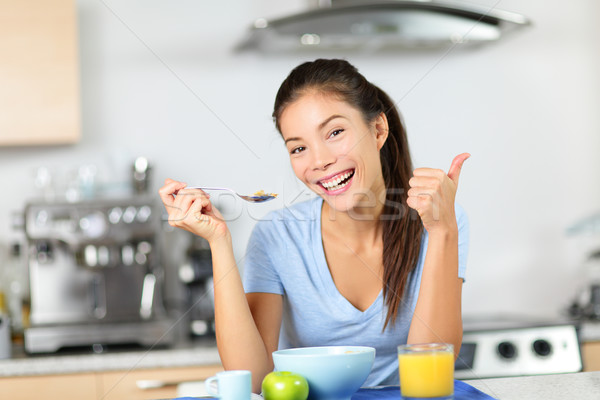 Woman eating breakfast cereals drinking juice Stock photo © Maridav