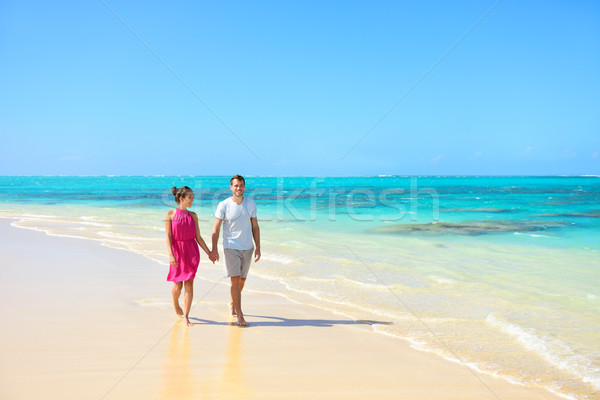 Summer vacation couple walking on beach landscape Stock photo © Maridav