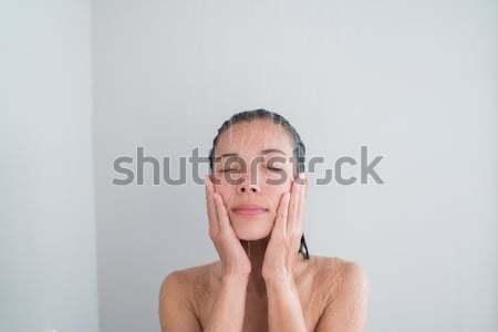 Shower woman showering relaxing washing face Stock photo © Maridav
