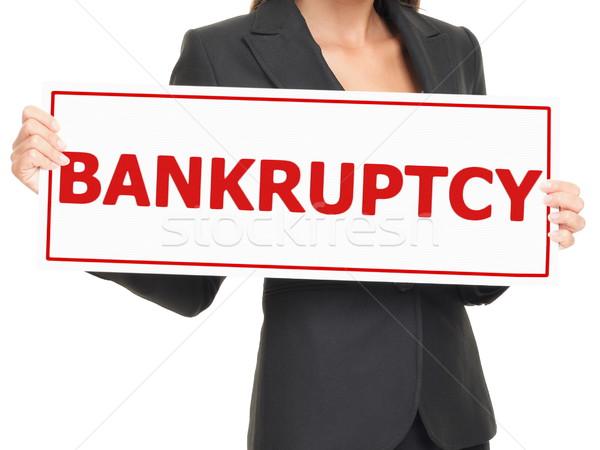 Csőd felirat üzletasszony tart fehér papír Stock fotó © Maridav
