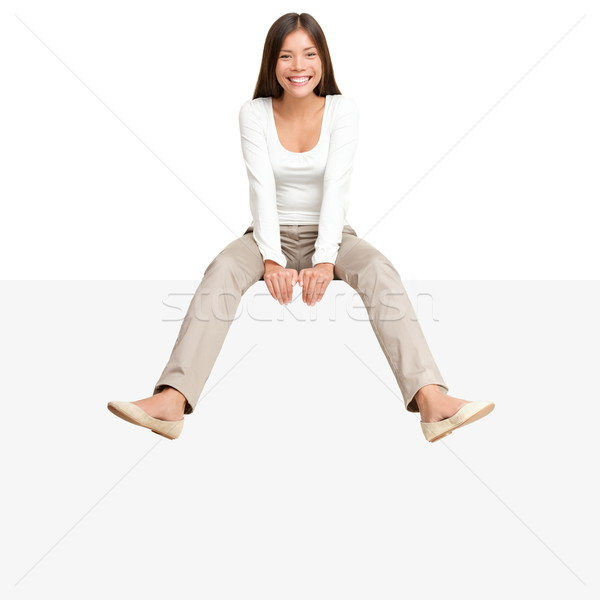 Woman sitting on billboard sign edge Stock photo © Maridav