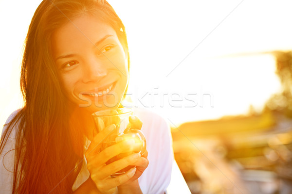 Woman drinking coffee in sunshine Stock photo © Maridav