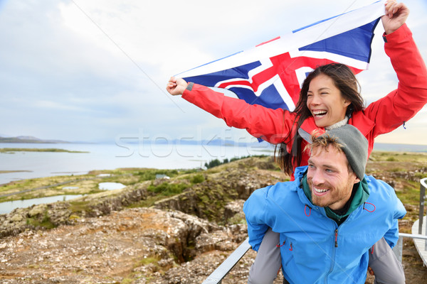 Iceland travel - couple with Icelandic flag Stock photo © Maridav